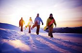 stock photo of mountain-high  - Group of snowboarders on top of the mountain - JPG