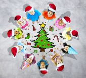 Kids with christmas hats and tree in grey background