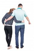 young couple pointing. Back view.  Rear view people collection.  backside view of person.  Isolated