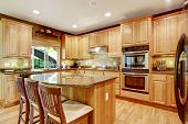 Modern Kitchen Rooom With Island And Granite Tops