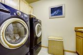 stock photo of laundry  - Modern purple appliances in ivory laundry room - JPG