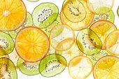 Sliced fruits background.