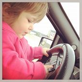 Adorable little baby driving car with instagram effect
