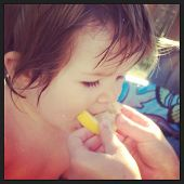 Adorable little baby eating lemon with instagram effect
