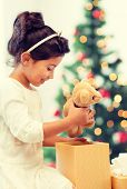 holidays, presents, christmas, x-mas concept - happy child girl with gift box and teddy bear