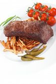 meat food : grill beef on potato chips with fresh tomato and hot green peppers isolated on white bac