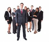 Senior Business Manager Standing On Front Of His Team