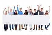 pic of excite  - Excited group of diverse people holding banner. Isolated on white