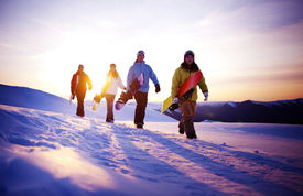 stock photo of snowboarding  - Group of snowboarders on top of the mountain - JPG