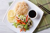 Asian Salad With Squid And Rice Noodles Horizontal Top View