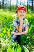 Boy with lilies of the valley