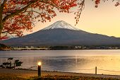Mt. Fuji with autumn foliage at Lake Kawaguchi in Japan.