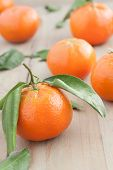 foto of backround  - vibrant tangerines with leaves on a wooden backround  - JPG