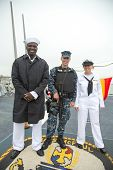 Unidentified sailor and marine on the deck of US guided missile destroyer USS McFaul