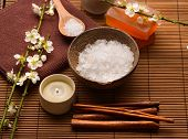 Spa setting with candle ,cherry flower ,towel, soap on mat