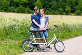stock photo of tandem bicycle  - Man and woman - JPG