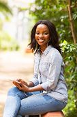 attractive afro american girl using smart phone
