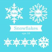 White Snowflakes On A Blue Background. Winter Sale. Discounts.