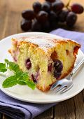 piece of homemade sweet pie with red grapes