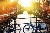 stock photo of bridge  - Amsterdam Bikes on the Channel Bridge. Amsterdam Netherlands.