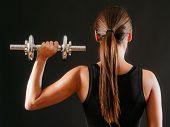 Female Doing Shoulder Press With Dumbbell