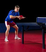 Young table tennis player isolated