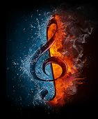 foto of treble clef  - Treble Clef in Fiere and Water isolated on Black Background - JPG
