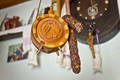 pic of canteen  - Traditional wooden carved canteen hanging with home made sausage - JPG