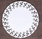 White doily on the vintage tablecloth