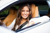 stock photo of driving  - Young woman driving her car - JPG