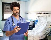 Portrait of a medical worker reading a document on a clipboard