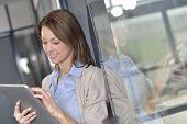 Businesswoman websurfing on digital tablet