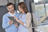 Business people working on digital tablet