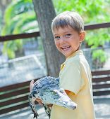 Boy with crocodile.