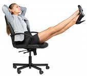 Businesswoman on office chair with her feet up