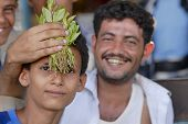 Men sell khat at the local market in Lahij, Yemen.