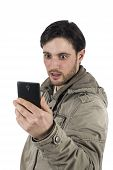 Shocked Young Man Checking His Smarphone Isolated