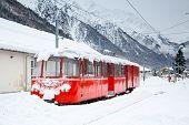 alpine red train Montenvers Mer de Glace in snow