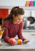 Young Housewife Exploring Checks After Grocery Shopping In Kitchen
