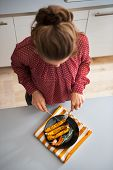 Young Housewife Eating Baked Pumpkin