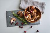 Closeup On Mushrooms Lingonberries And Rosmarinus On Table