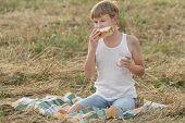 Teenage Farmer Boy Eating Fresh White Bread