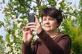 Woman Photographs Itself Against Blossoming Apple