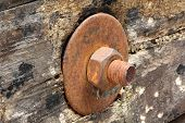 rusted bolt with nut. Grunge industrial construction