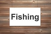 White Canvas On Wooden Wall Fishing