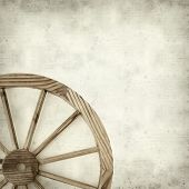 picture of wagon wheel  - textured old paper background with old wagon wheel - JPG