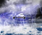 image of storms  - The plane flies through a storm with lots of lightning in a storm - JPG