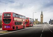 Two London Buses With Big Ben In London, England