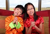 Two Kids Offering Chinese New Year Greetings