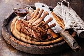 picture of veal meat  - Raw fresh marinated veal ribs and meat cleaver on wooden background - JPG